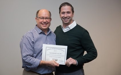 An image of Ron Hruska and Neal Hallinan receiving the PRT